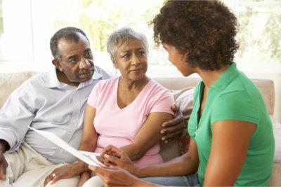 therapist assisting senior couple