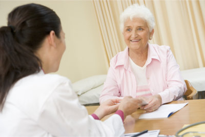 senior woman talking to a caregiver