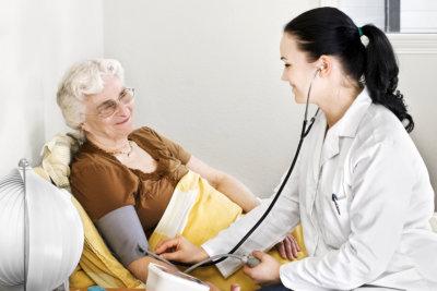 Senior lady having blood pressure check